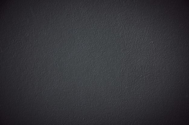 Vieux grunge noir et texture rugueuse de plâtre de mur pour le fond