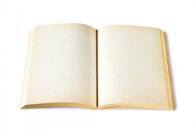Vieux livre blanc ouvert isolé sur blanc