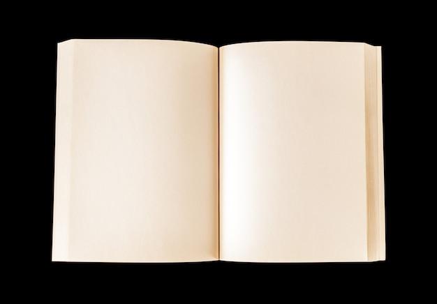 Vieux livre blanc ouvert isolé