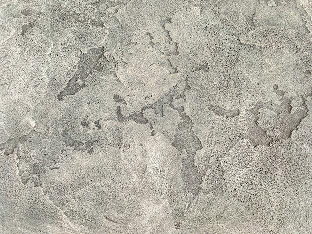 Vieux mur beige recouvert de plâtre inégal. texture de la surface de la pierre de sable minable vintage, gros plan.