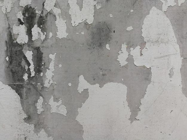 Vieux mur de béton blanc avec des fissures de peinture. texture de fond
