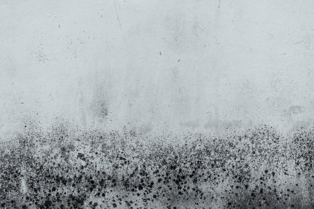 Vieux mur de béton noir et blanc