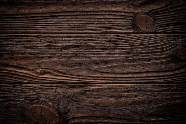 Vieux mur en bois brun, texture de fond détaillée. clôture en planches de bois se bouchent.