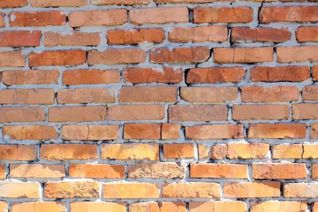 Vieux mur de briques rouges les briques sont posées en rangées grunge stone texture