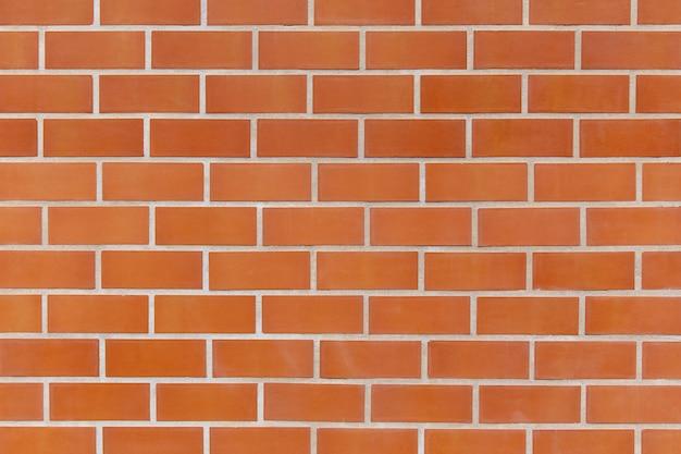 Vieux mur de briques rouges texture d'arrière-plan se bouchent