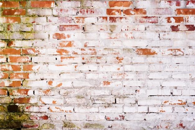 Vieux mur de briques rouges vintage avec texture de joints de ciment