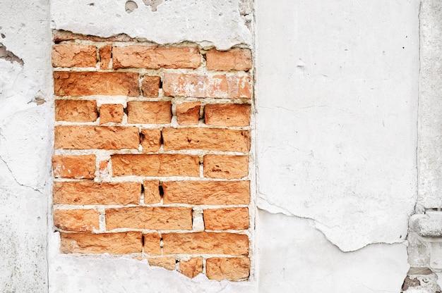 Vieux mur de briques avec tombé face