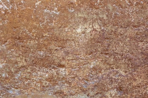 Vieux mur brun endommagé