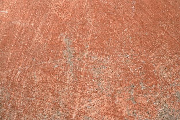 Vieux mur de ciment d'un bâtiment avec de la peinture fissurée fond et texture âgés