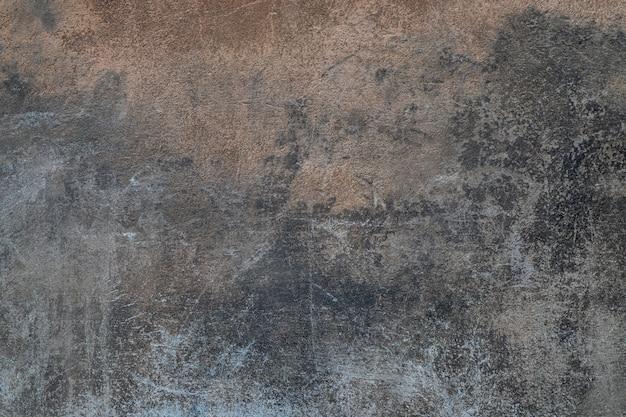 Vieux mur de ciment en béton gris foncé