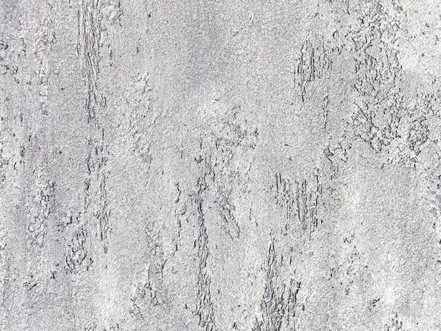 Vieux mur gris recouvert de plâtre inégal. texture de fond de surface en pierre argent minable vintage