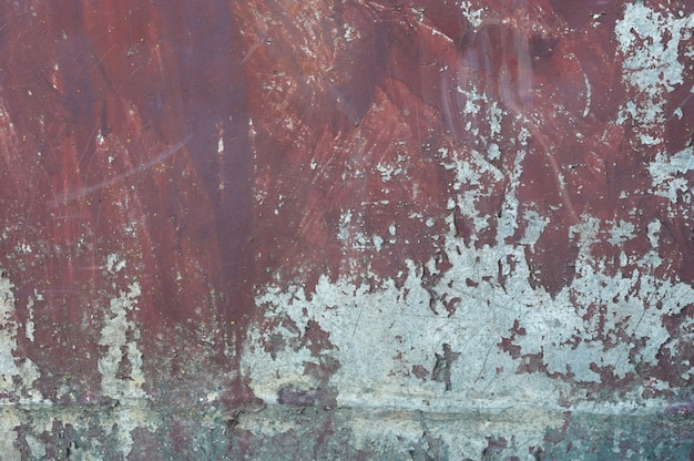 Vieux mur de métal orange en rouge