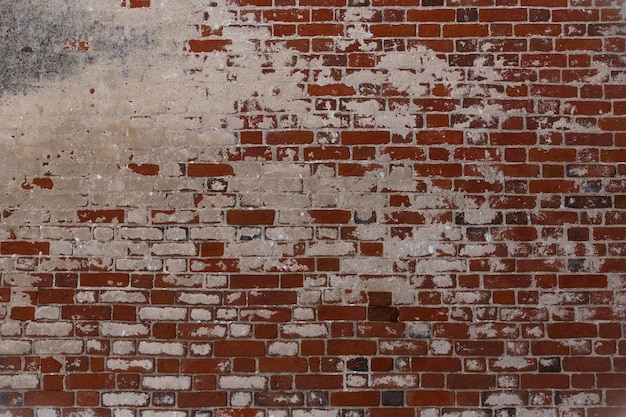 Vieux mur de texture fait de briques colorées et blanches