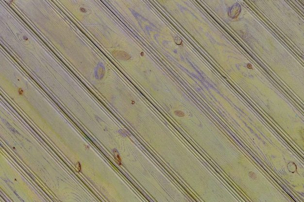 Vieux panneaux jaunes texture diagonale vieux fond de bois