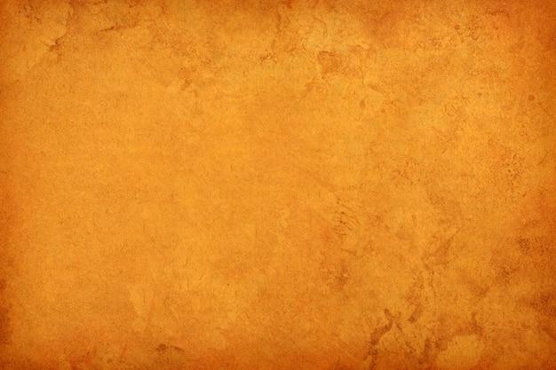 Vieux papier brun grunge pour le fond. texture abstraite de couleur café liquide.
