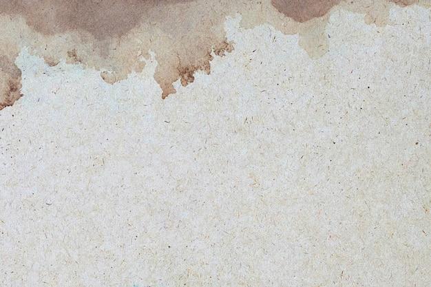Vieux papier brun grunge pour mur. texture de couleur café liquide abstraite.