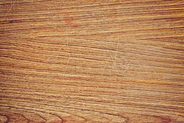 Vieux plateau de bureau en bois avec texture scratch pour la conception de fond