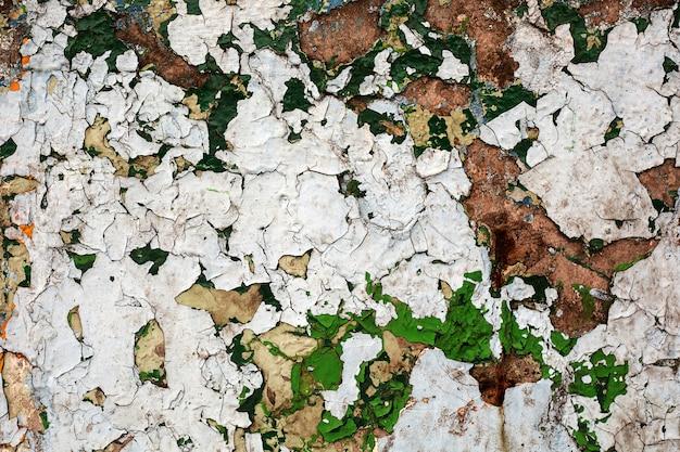 Vieux plâtre fissuré sur le mur. texture béton grunge.