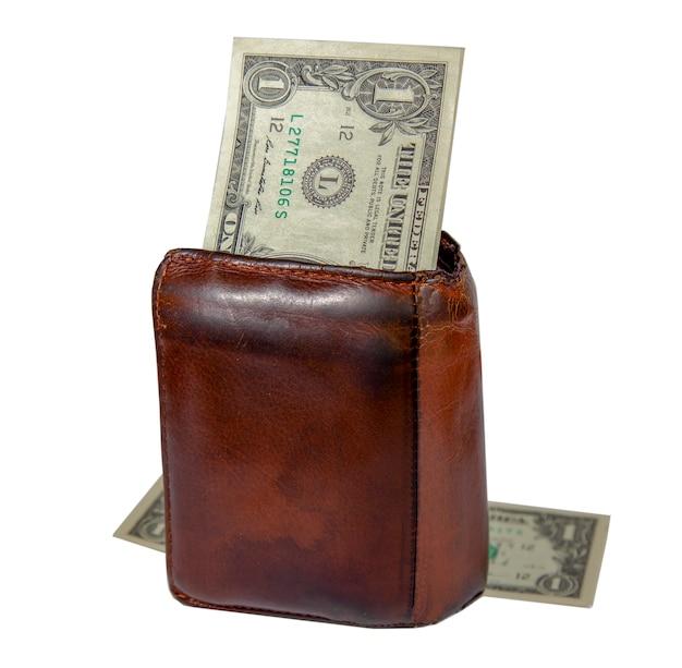 Vieux portefeuille en cuir marron pour homme et billet d'un dollar