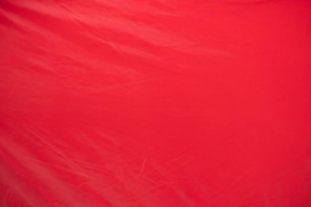 Vieux rouge froissé avec fond rugueux de texture de papier de page de tissu de tente. pli grunge parchemin modèle vintage design