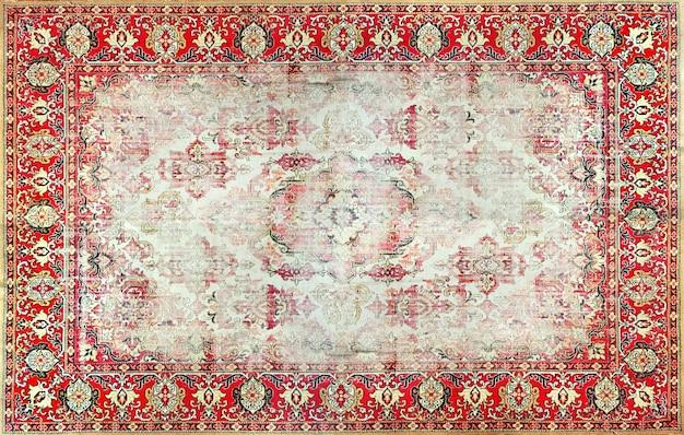Vieux rouge vintage, texture de tapis persan grunge, ornement abstrait