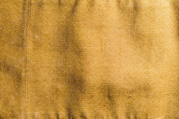 Vieux sac à dos ou sac ou uniforme de camouflage d'armée militaire fané