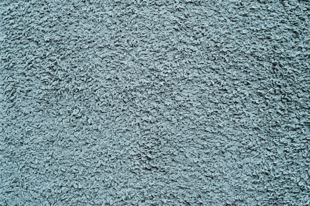Vieux tapis bleu pour le fond et la texture.