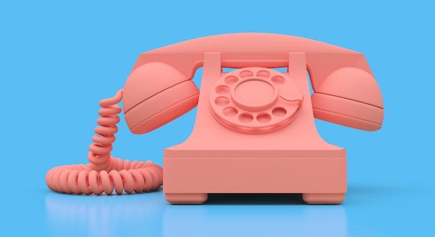 Vieux téléphone à cadran rose sur une surface bleue