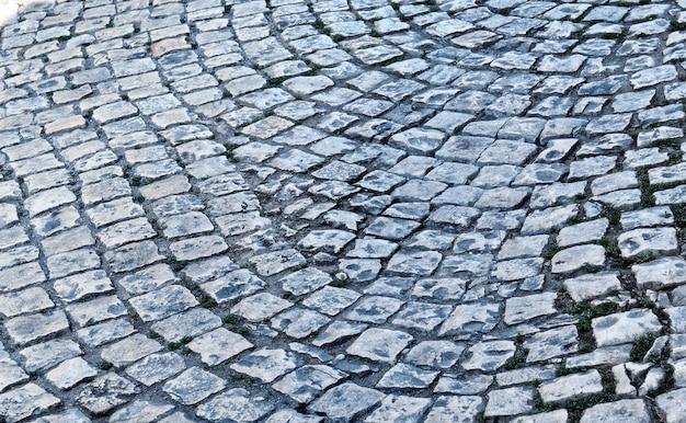 Vieux trottoir pavé en gros plan. texture pour pavé. abstrait structuré.