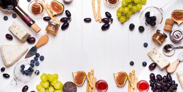 Vin blanc, raisin, pain, miel et fromage