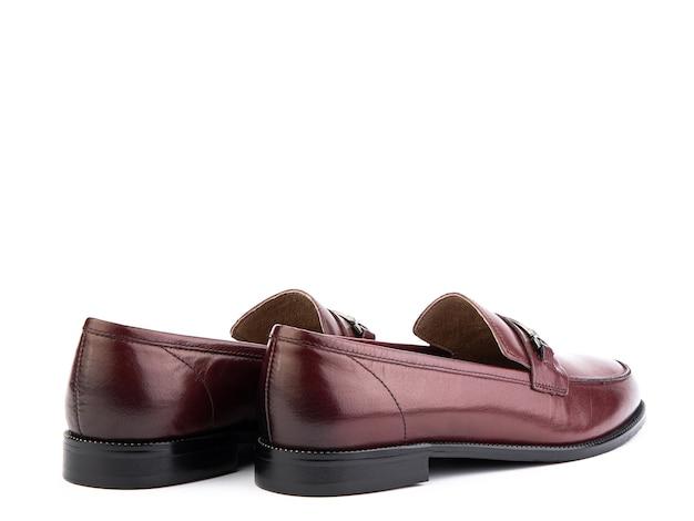 Vintage womens loafer shoes gros plan publicitaire tourné en cuir chaussures rouges concept chaussures gros plan