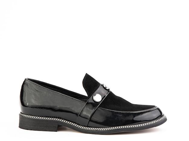 Vintage womens loafer shoes gros plan publicité shot chaussures noires en cuir avec sued