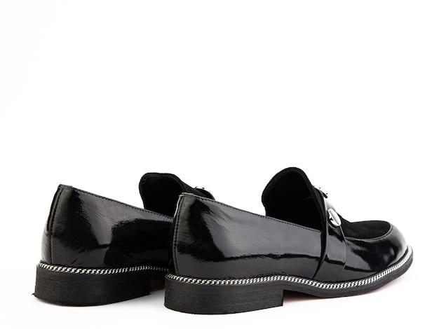 Vintage womens loafer shoes gros plan publicité shot chaussures noires en cuir