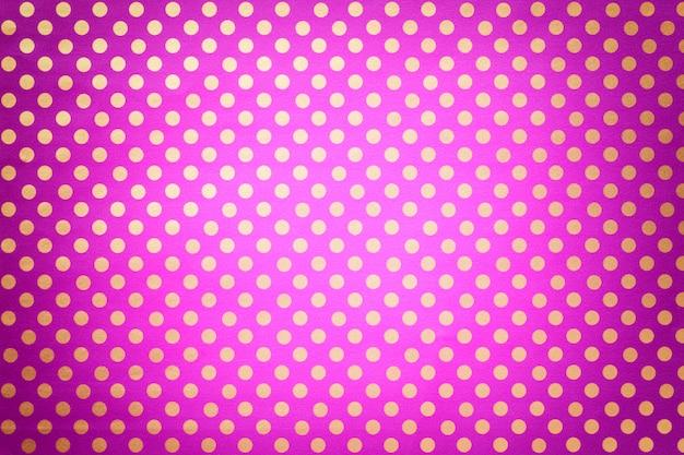 Violet clair de papier d'emballage avec un motif de pois dorés