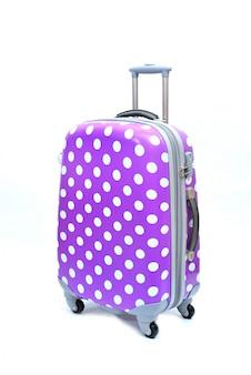 Violet de grande valise moderne sur un blanc