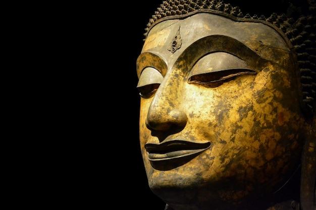 Visage de bouddha en bronze antique
