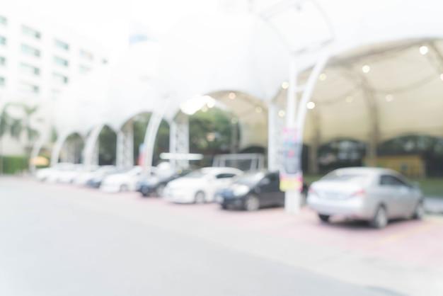 Voiture de stationnement abstraite et floue