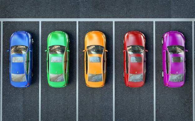 Des voitures colorées sont dans le parking ou se préparent pour la course