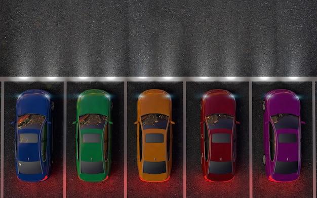 Des voitures colorées sont sur le parking ou se préparent pour la course. nuit