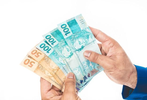 Vrais billets en monnaie brésilienne brl avec fond rouge