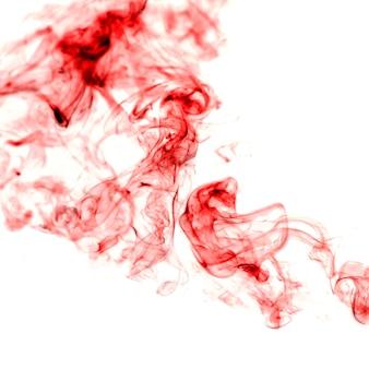 Vrilles de fumée rouge