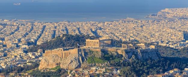 Vue de l'acropole au coucher du soleil athènes grèce