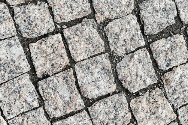 Vue aérienne de la texture de la rue pavée. texture de la chaussée en pierre. photo de haute qualité