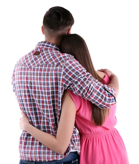 Vue arrière du jeune couple isolé sur blanc