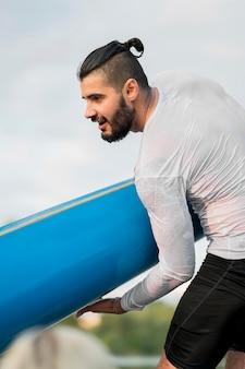 Vue côté, homme, tenue, kayak