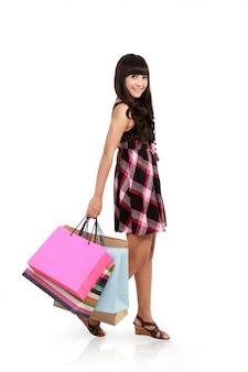 Vue côté, de, tenue femme, sacs provisions