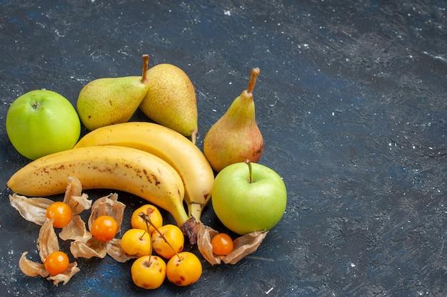 Vue de dessus bananes jaunes paire de baies avec des pommes vertes fraîches poires sur le fond bleu foncé baies de fruits frais santé vitamine sweet