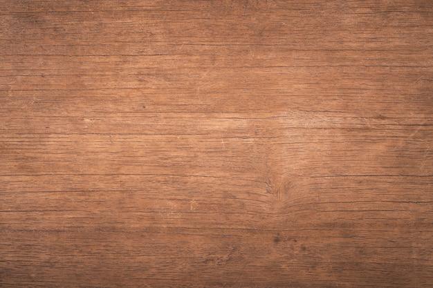 Vue de dessus bois brun avec fissure, vieux fond en bois texturé sombre grunge, la surface de la texture de bois brun ancien