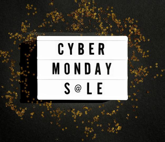 Vue de dessus de la boîte à lumière cyber lundi avec des paillettes dorées