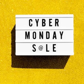 Vue de dessus de la boîte à lumière pour cyber lundi avec des paillettes dorées